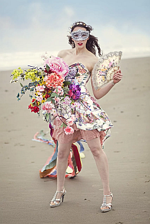 image of a woman with flowers wearing a mask on the beach