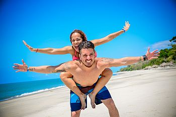 couple piggback on beach